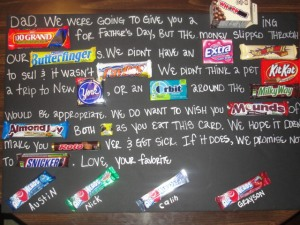 candy gram- black poster with words and candy bars on it