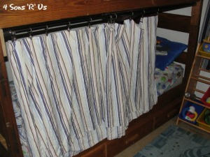 4 Sons 'R' Us: Bottom Bunk Bed Fort- a striped curtain drawn on a tension rod across a wooden twin bunk bed