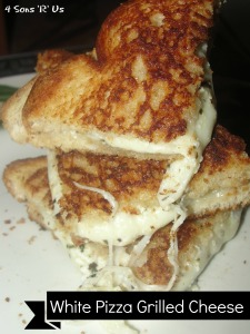 4 Sons 'R' Us: 3/4's of a White Pizza Grilled Cheese sandwich stacked on top of each other with melted cheese and herbs showing