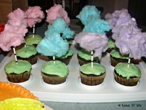 Lorax Party truffula tree cupcakes made from cotton candy tufts on lollipop sticks stuck in homemade cupcakes