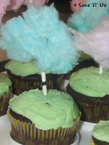 'The Lorax' Themed Birthday Party- Lorax Party truffula tree cupcakes made from cotton candy tufts on lollipop sticks stuck in homemade cupcakes