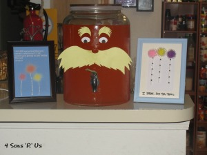 The Lorax Themed Birthday Party character punch and pictures shown on display