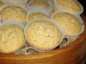 Healthy Applesauce & Oat Muffins in a wooden bowl lined with burlap