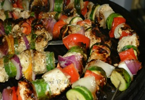 Grilled Greek Chicken Kebabs on the grill being cooked