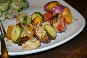 Grilled Greek Chicken Kebobs removed from skewers onto a white plate
